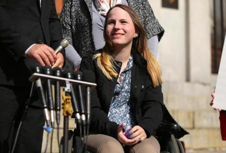 Justina Pelletier smiled as she listened to reporters' questions in front of the State house Thursday with her parents, Linda and Lou.